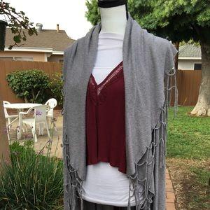 Sleeveless, long boho sweater with tassels